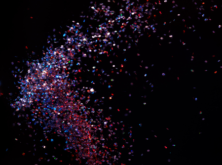 glimmer: Lots of shiny sequins over the dark background Stock Photo