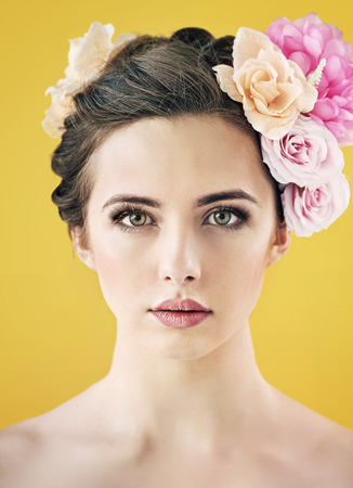 Pretty young woman with flower put in hair Stock Photo