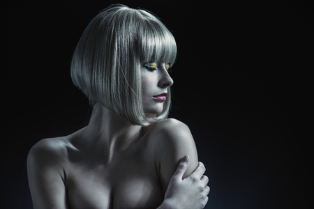 hairpiece: Attractive woman with a blond hairpiece on her head Stock Photo