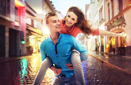 Beautiful young couple having fun on a rainy day Imagens - 50424974
