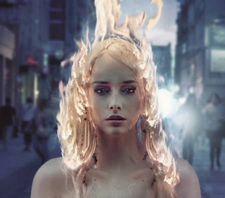 Conceptual portrait of a lady with burning coiffure
