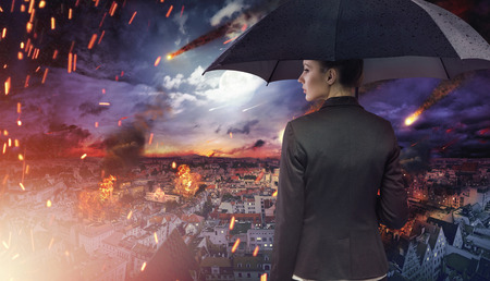 Attractive brunette lady staring at the natural disaster