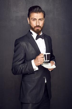 addiction drinking: Elegant handsome guy drinking coffee Stock Photo