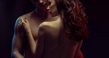 nude: Portrait of two young lovers in dark bedroom
