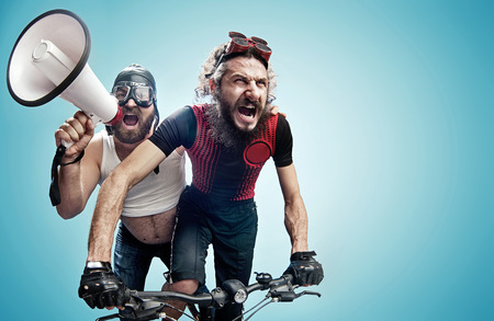 Two hilarious bicyclists involved in a contest