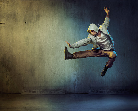 Athletic dancer in a super jumping pose Standard-Bild
