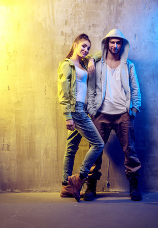 Portrait of two young hip-hop dancers on a concrete background