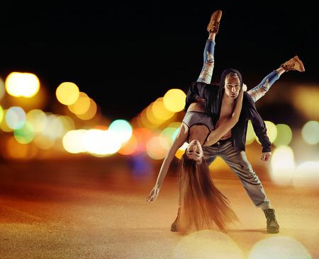 hip hop man: Tough hip hop man dancing with his girlfriend
