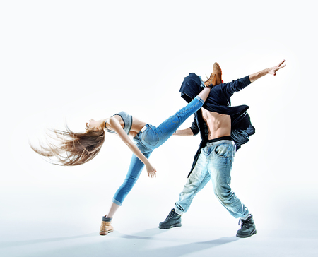 Two athletic young dancers making a performance