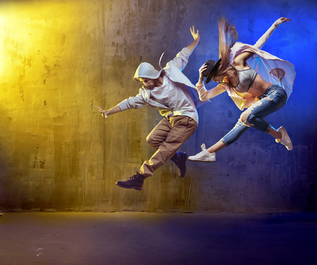 hip hop dance: Stylish dancers fancing in a concrete place
