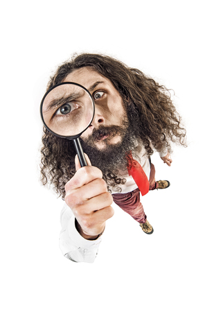 fisheye: Fish-eye image of a worker holding a magnifying glass