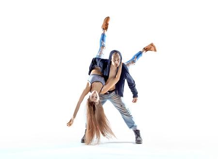Strong hip-hop boy carrying his dance partner