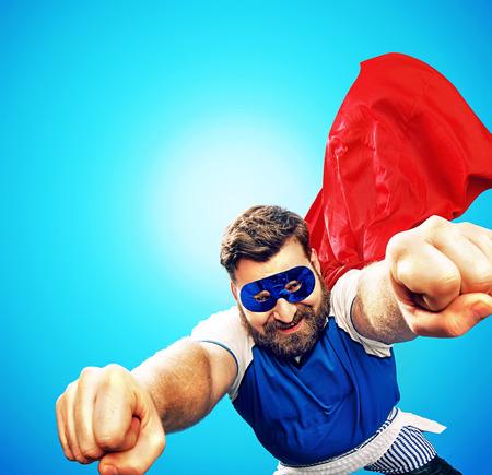 Brave heroe flying over the city Standard-Bild