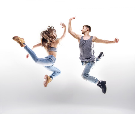 easy going: Dancing couple over the bright background
