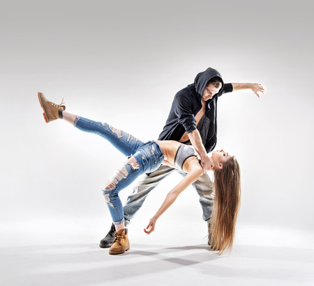 Acrobat pose of a two talented, young dancers Banco de Imagens - 53129415