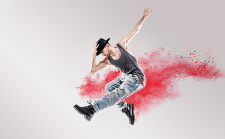 easy going: Conceptual picture of hip hop dancer among red powder