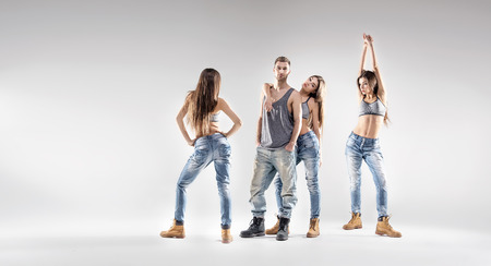 easy going: Handsome dancer with pretty hip-hop ladies Stock Photo