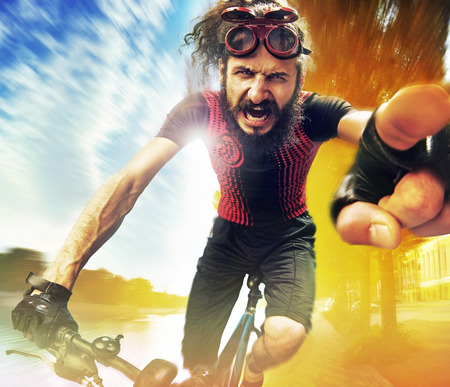 Funny image of a shouting bicyclist