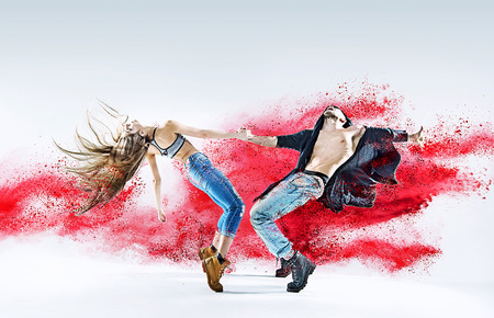 Conceptual image of a dancing young couple Фото со стока