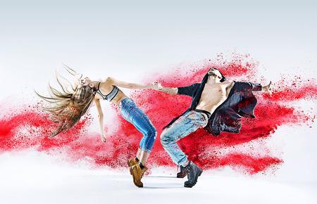 Imagem conceptual de um jovem casal a dançar Banco de Imagens