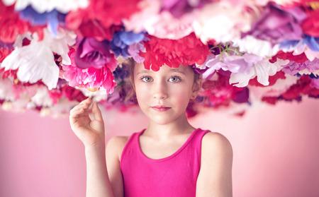 cutie: Cute little cutie among colorful flowers