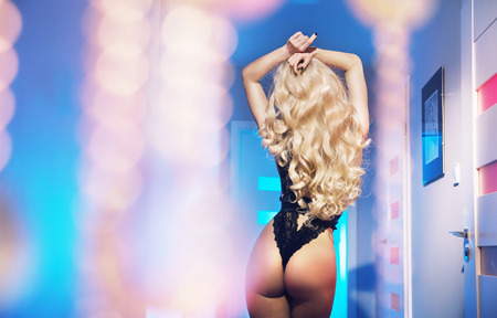 Attractive blond lady moving her sexy body Stok Fotoğraf