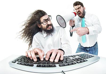 Bully boss yelling at the nerdy employee