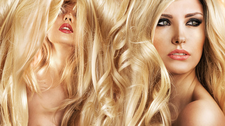 color hair: Two attractive blond women in a beauty salon Stock Photo