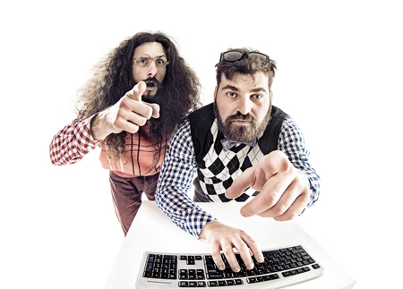 computer isolated: Two hilarious guys staring at the monitor Stock Photo