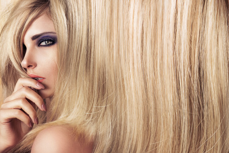 hairpiece: Closeup art portrait of a young, blond model with long straight hair