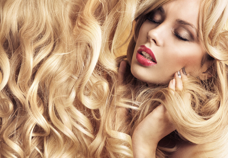 hairpiece: Calm blond lady with tumbling blond curls