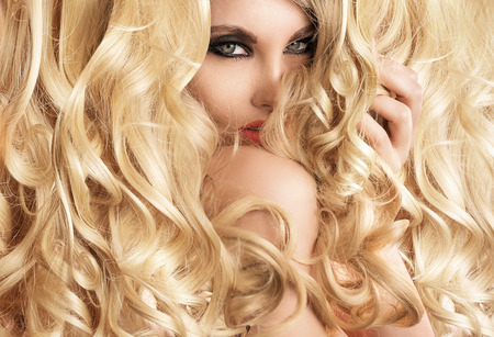 hairpiece: Beautiful woman with blond tumbling curls Stock Photo