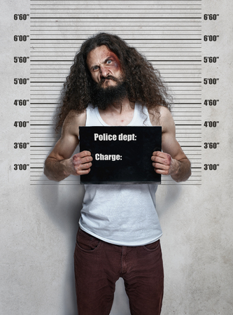 Funny portrait of a skinny hardened criminal