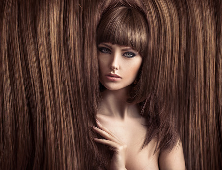 hair and beauty: Sensual lady with a fluffy hairstyle