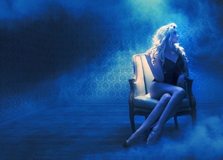 Blond sensual lady in a mysterious room Standard-Bild