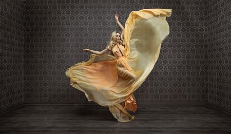Gorgeous expressive blond woman wearing fabulous dress
