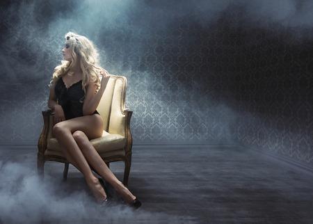 Sexy young woman among white, dense smoke