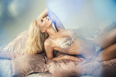 Sensual lady lying in a bed Stock Photo