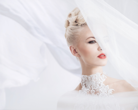 voile: Elegant blond woman with a bright veil on the head