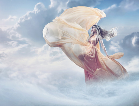 Fairy image of a beautiful young woman in the clouds 写真素材