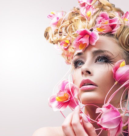 beautiful flowers: Beauty model woman with beautiful flowers in her hair Stock Photo