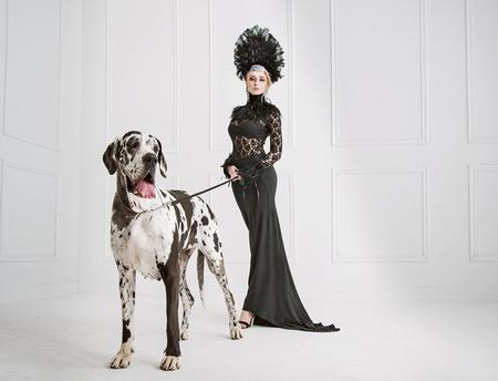 Lady in black with a big, friendly dog