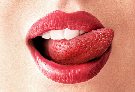 Closeup image of a red strawberry tongue photo
