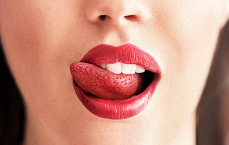 Conceptual image of a pure red strawberry tongue photo