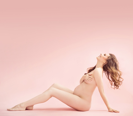 naked belly: Portrait of a pretty nude pregnant woman Stock Photo