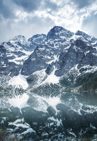 majestic mountain: Majestic mountain with a clear lake below Stock Photo