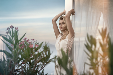 Alluring blond woman relaxing in the tropics photo