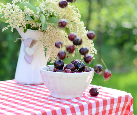 Lots of fresh sweet cherrie in the bowl Stock Photo