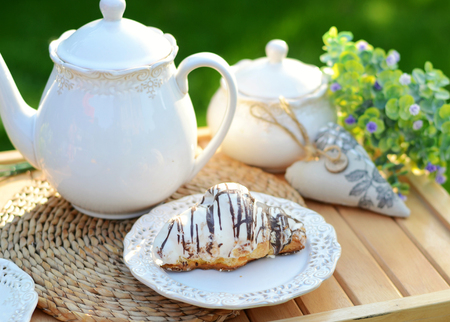 Image of a sweet breakfast in the summer garden Stock Photo