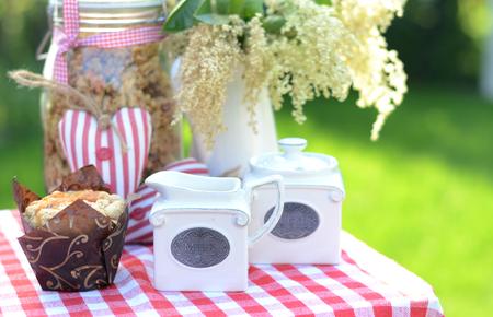 breakfast garden: Tasty, sweet breakfast in the summer, green garden Stock Photo